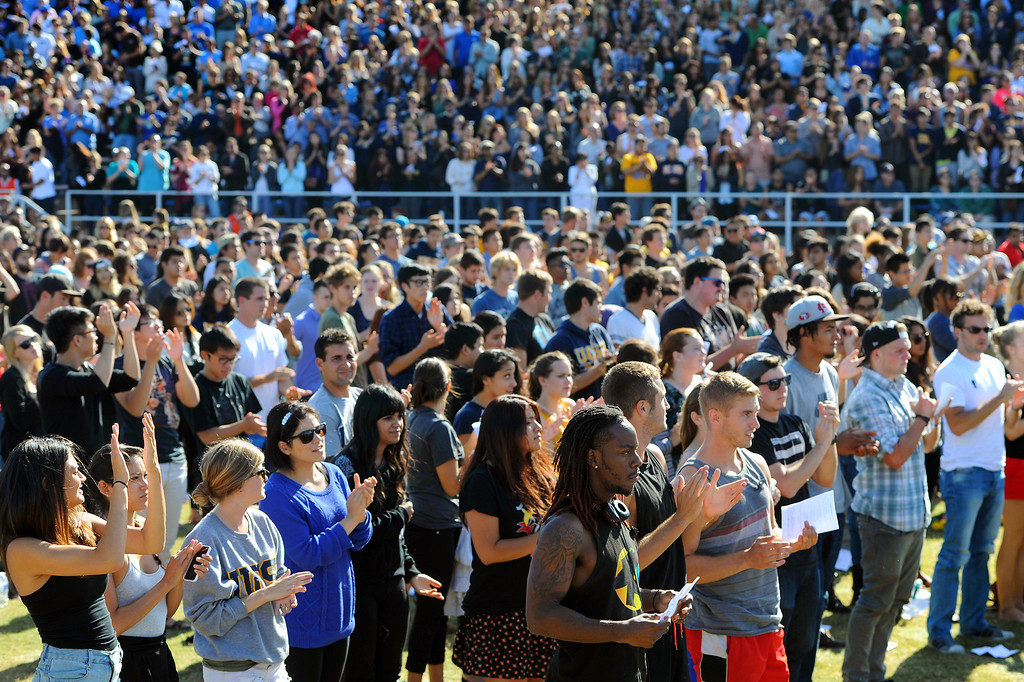 . People applaud Richard Martinez, the father of slain student Christopher Ross Michaels-Martinez, during a memorial service at Harder Stadium at UCSB for the victims of Friday\'s Isla Vista rampage, Tuesday, May 27, 2014. (Photo by Michael Owen Baker/Los Angeles Daily News)