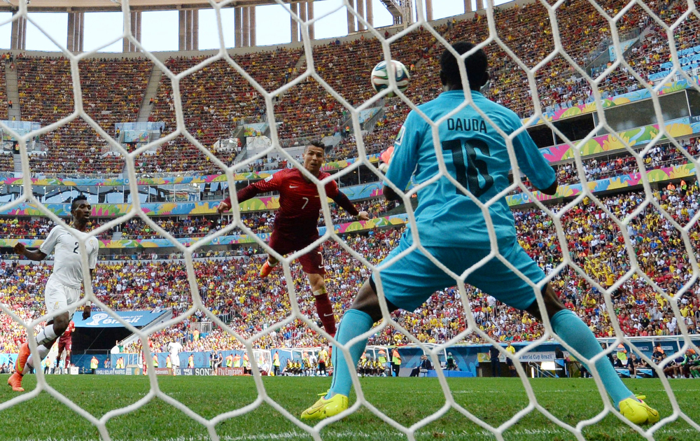 . Portugal\'s forward and captain Cristiano Ronaldo (C) has his header saved by Ghana\'s goalkeeper Fatau Dauda (R) during the Group G football match between Portugal and Ghana at the Mane Garrincha National Stadium in Brasilia during the 2014 FIFA World Cup on June 26, 2014.  (CARL DE SOUZA/AFP/Getty Images)