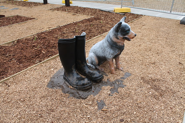 Dog and boots sculpture
