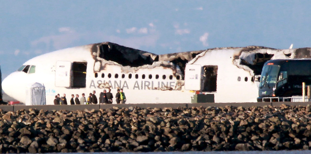 . Three charter buses, reportedly caring passengers from Asiana Airlines Flight 214 pull away after visiting the crash site at San Francisco International Airport, in South San Francisco, Calif., on Wednesday, July 10, 2013. The Boeing 777 plane operated by a Korean airline crashed as it was landing at SFO on Saturday, July 6 killing two and injuring close to 200 passengers. (Anda Chu/Bay Area News Group)