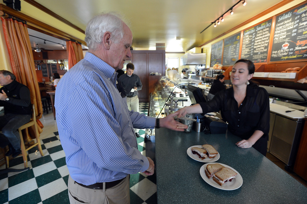 . Richmond city council member Tom Butt buys a sandwich at Little Louie\'s in the Point Richmond area of Richmond, Calif. on Thursday, Jan. 24, 2013. (Kristopher Skinner/Staff)