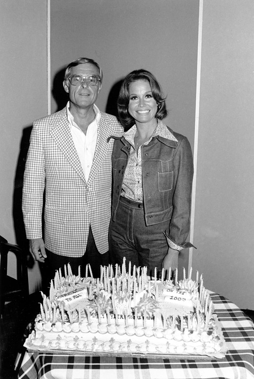 ". Actress Mary Tyler Moore is joined by her husband, Grant Tinker, in celebrating the taping of the 100th ""Mary Tyler Moore Show\"" at CBS in Los Angeles, Ca. in June 1974. Tinker is the president and Moore is chairman of MTM Enterprises. (AP Photo)"