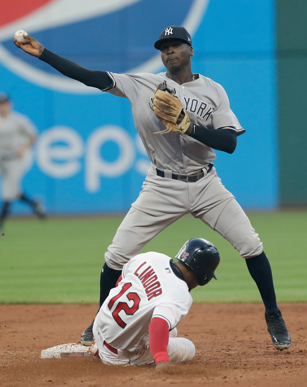 . New York Yankees\' Didi Gregorius throws to first base after getting Cleveland Indians\' Francisco Lindor out at second base during the fifth inning of a baseball game, Thursday, July 12, 2018, in Cleveland. Michael Brantley was out at first base for the double play. (AP Photo/Tony Dejak)