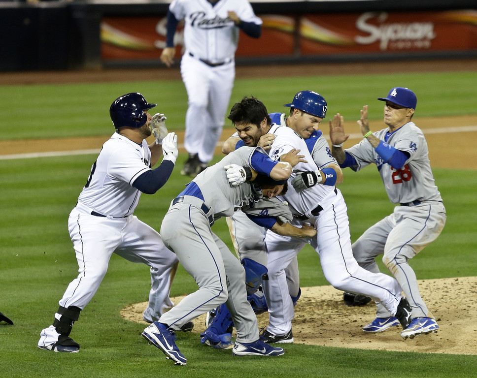 . San Diego Padres\' Carlos Quentin, center, and teammates battle the Los Angeles Dodgers after Quentin was hit by a pitch thrown by Angeles Dodgers  pitcher Zack Greinke  in the sixth inning of baseball game in San Diego, Thursday, April 11, 2013. (AP Photo/Lenny Ignelzi)