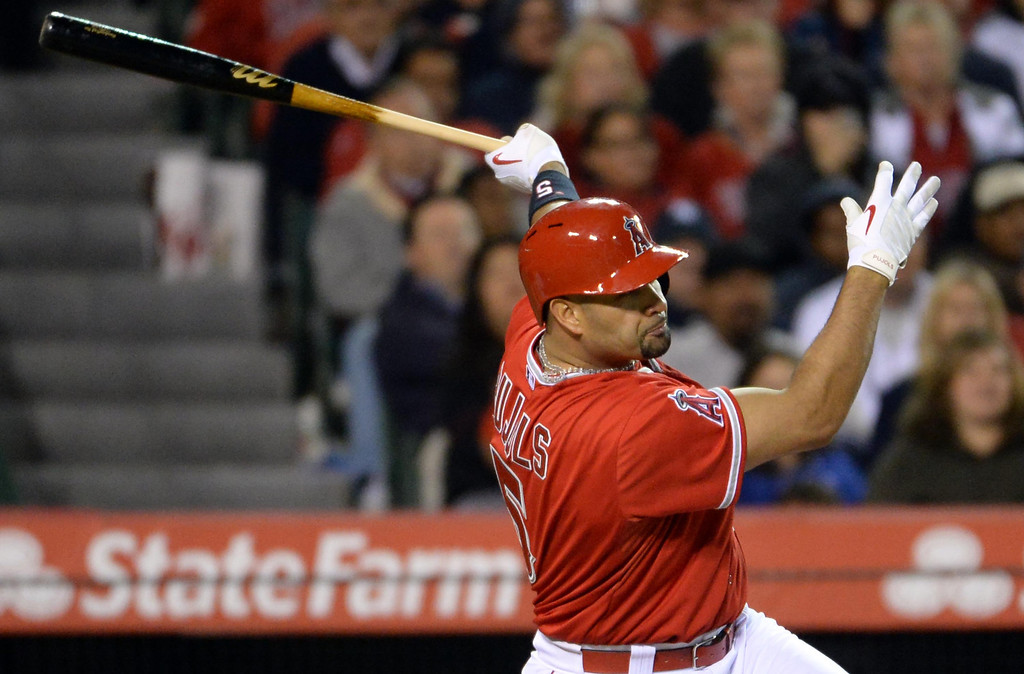. Los Angeles Angels\' Albert Pujols watches his RBI single as Mike Trout (not pictured) scores to tie the game at 3-3 in the eighth inning of a baseball game against the New York Yankees at Anaheim Stadium in Anaheim, Calif., on Tuesday, May 6, 2014.  (Keith Birmingham Pasadena Star-News)