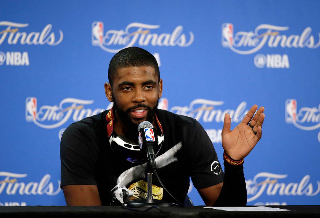 . Cleveland Cavaliers\' Kyrie Irving fields questions during a post-game press conference after Game 7 of basketball\'s NBA Finals Sunday, June 19, 2016, in Oakland, Calif. Cleveland won 93-89. (AP Photo/Eric Risberg)
