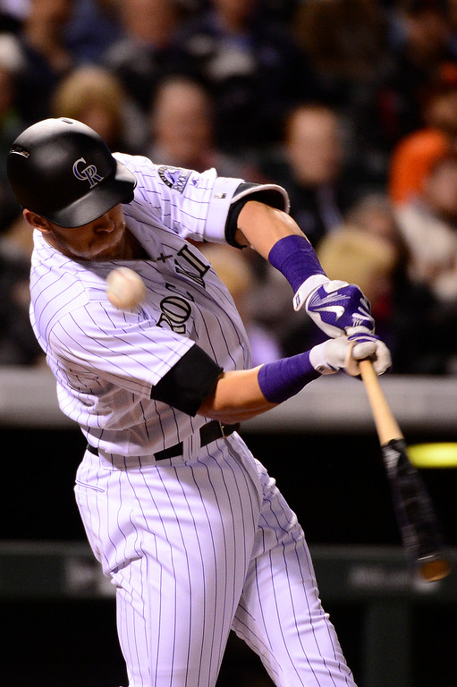 . DENVER, CO - APRIL 12: Colorado Rockies shortstop Trevor Story (27) swings at a ball during the fifth inning at Coors Field on April 12, 2016 in Denver, Colorado. (Photo by Brent Lewis/The Denver Post)