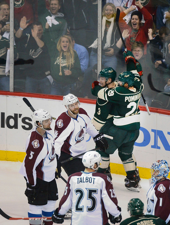 . Minnesota wing Jason Pominville (29) embraced center Charlie Coyle (3) after his goal in the second period.   (Photo by Karl Gehring/The Denver Post)