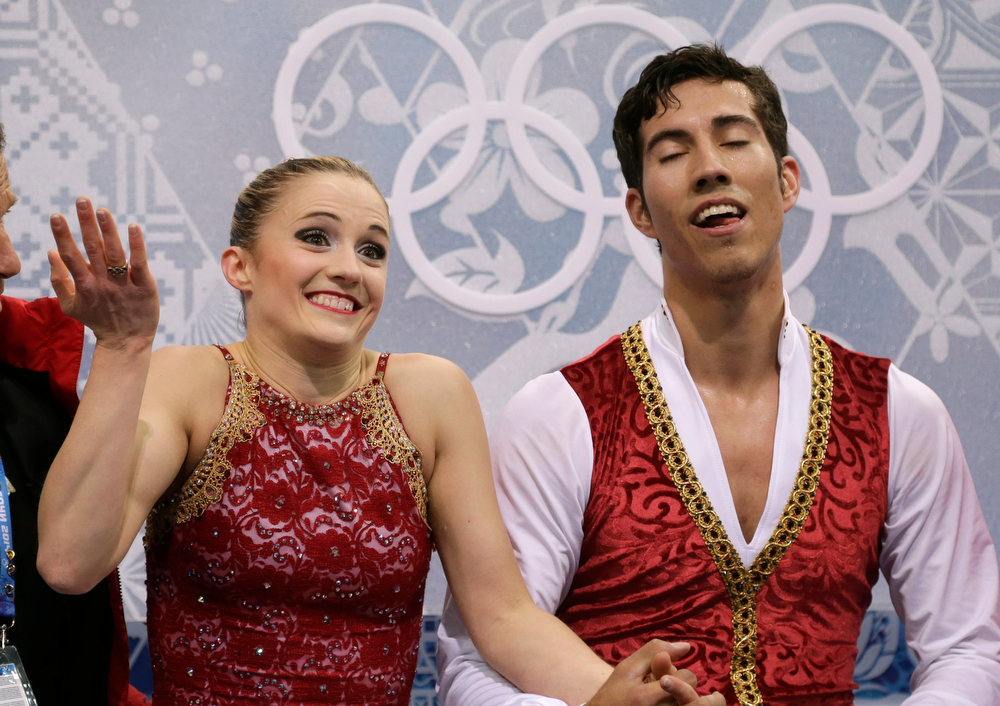 . Paige Lawrence and Rudi Swiegers of Canada wait in the results area after competing in the pairs free skate figure skating competition at the Iceberg Skating Palace during the 2014 Winter Olympics, Wednesday, Feb. 12, 2014, in Sochi, Russia. (AP Photo/Darron Cummings)
