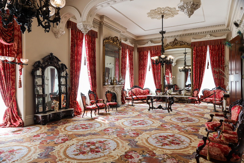 Elaborately decorated Southern home in hues of red and gold.