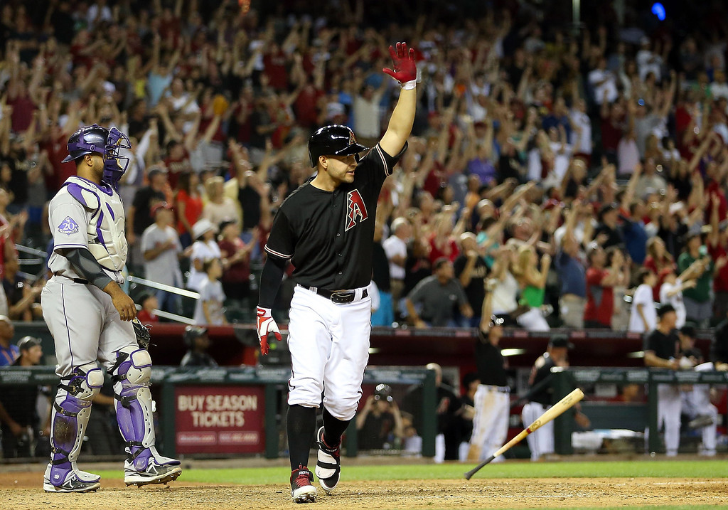 . Cody Ross #7 of the Arizona Diamondbacks reacts after hitting a walk off sacrifice fly to defeat the Colorado Rockies 3-2 in the 10th inning of the MLB game at Chase Field on April 27, 2013 in Phoenix, Arizona.  (Photo by Christian Petersen/Getty Images)