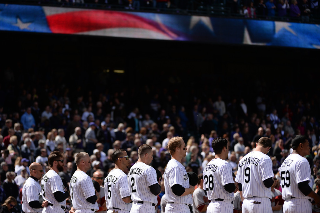 . Colorado Rockies players stand for the National Anthem before the game.  (Photo by Hyoung Chang/The Denver Post)