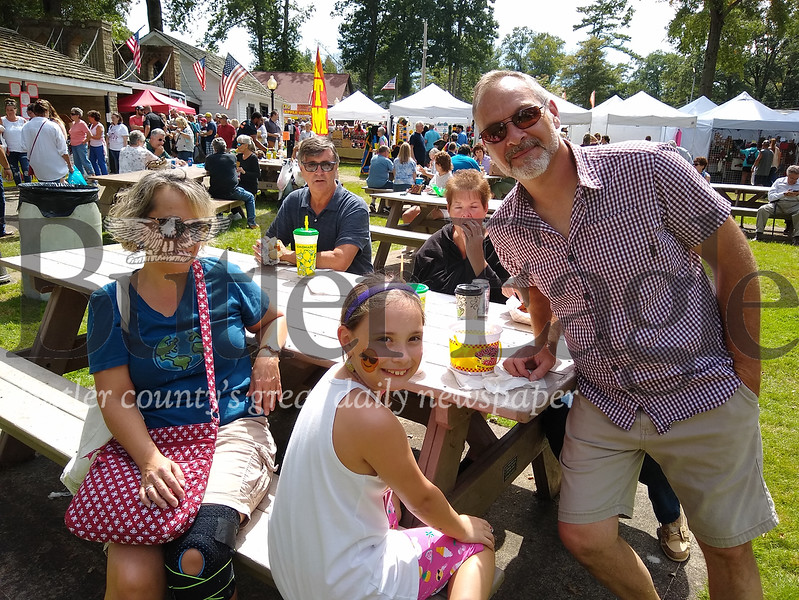From left, Kris Kamer, daughter Emma, 9, and husband John, all of Saxonburg Sunday at the Saxonburg Arts Festival. taken by Donna Sybert/Butler Eagle