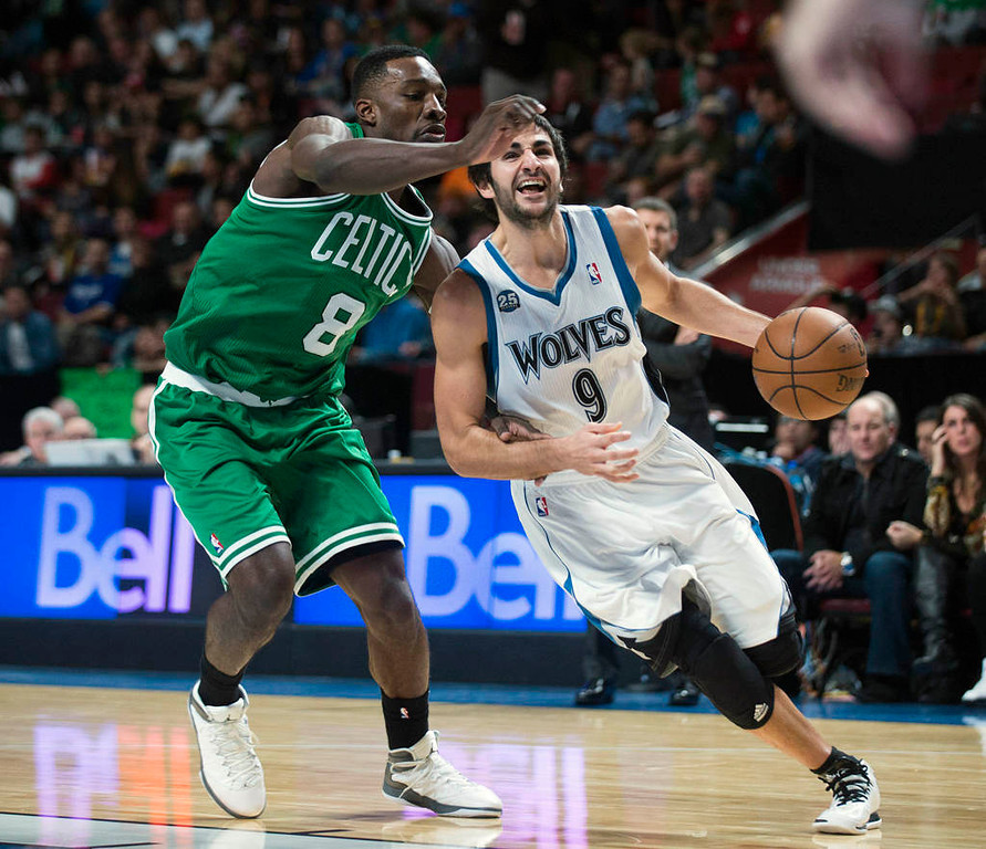 . Minnesota Timberwolves\' Ricky Rubio, right, drives to the net as Boston Celtics\' Jeff Green defends during the third quarter of an NBA preseason basketball game in Montreal, Sunday, Oct. 20, 2013.  (AP Photo/The Canadian Press, Graham Hughes)