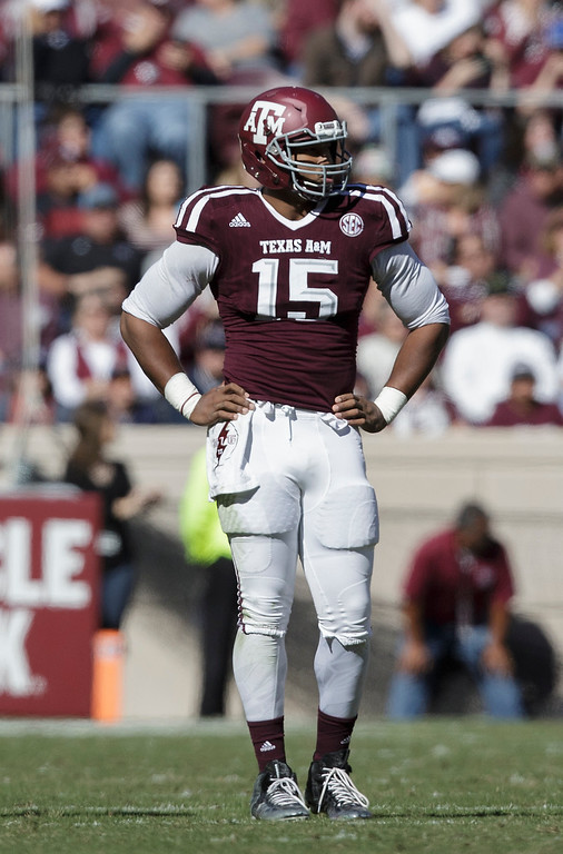 . Texas A&M defensive lineman Myles Garrett (15) waits the start of a play against UTSA during the first quarter of an NCAA college football game Saturday, Nov. 19, 2016, in College Station, Texas. (AP Photo/Sam Craft)
