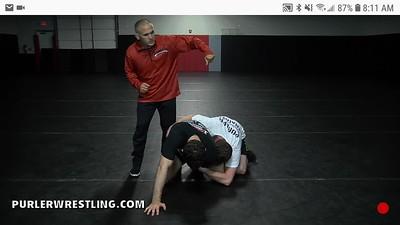 Roll through tilt - grabbing through back leg