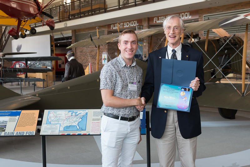 "Ryan Morris with John Mather, in front of Curtiss Jenny JN-4 -- An award luncheon, ""Dr. John Mather Nobel Scholars Program Award"", as part of the National Space Grant Foundation. College Park Aviation Museum, College Park, MD, August 2, 2019."