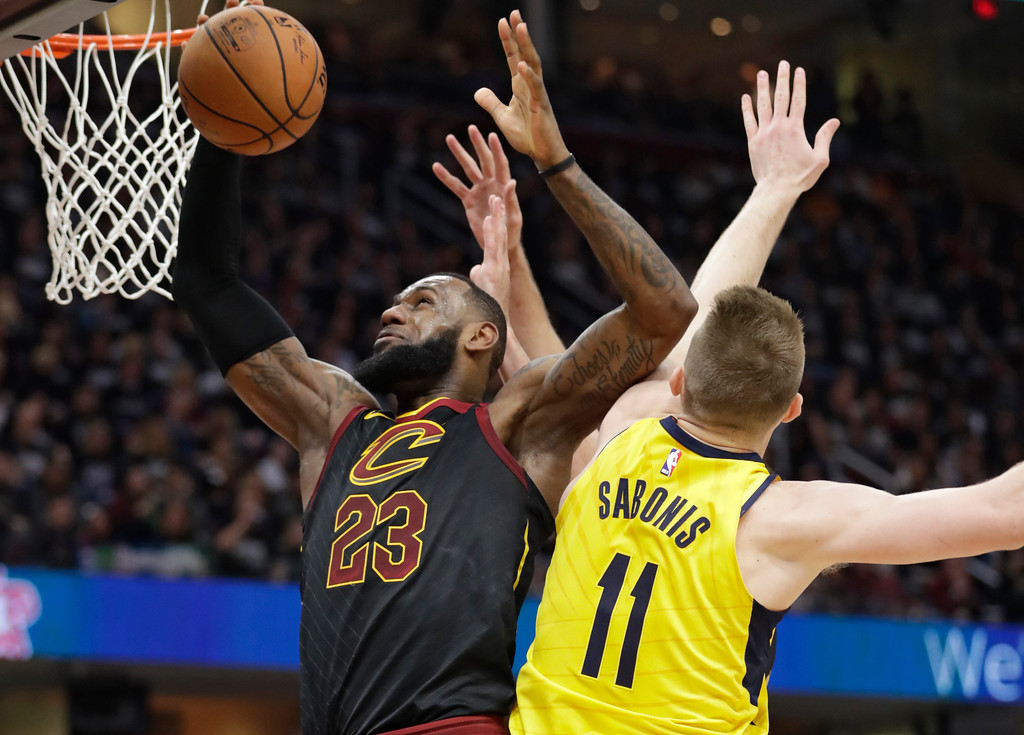 . Cleveland Cavaliers\' LeBron James (23) drives to the basket against Indiana Pacers\' Domantas Sabonis (11), from Lithuania, in the first half of Game 1 of an NBA basketball first-round playoff series, Sunday, April 15, 2018, in Cleveland. (AP Photo/Tony Dejak)