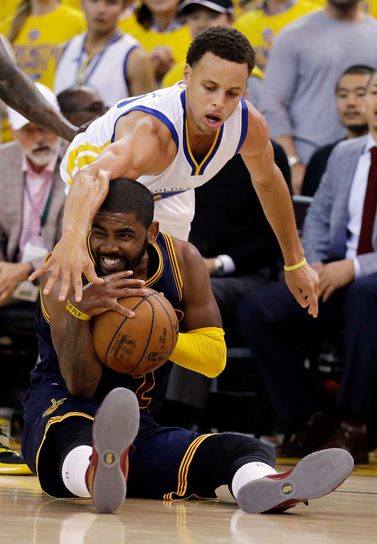 . Cleveland Cavaliers guard Kyrie Irving, bottom, is guarded by Golden State Warriors guard Stephen Curry during the second half of Game 1 of basketball\'s NBA Finals in Oakland, Calif., Thursday, June 4, 2015. (AP Photo/Ben Margot)