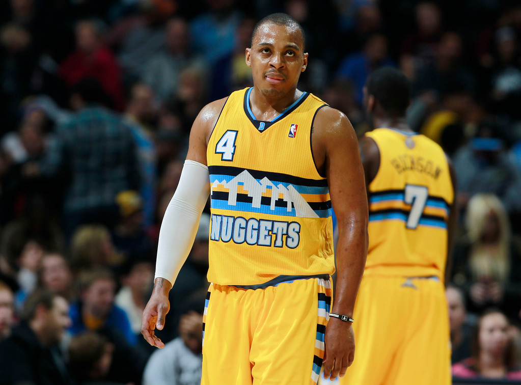 . After squandering a double-digit lead, Denver Nuggets guard Randy Foye reacts as time runs out in the fourth quarter of the Phoenix Suns\' 103-99 come-from-behind victory over the Nuggets in an NBA basketball game in Denver on Friday, Dec. 20, 2013. (AP Photo/David Zalubowski)
