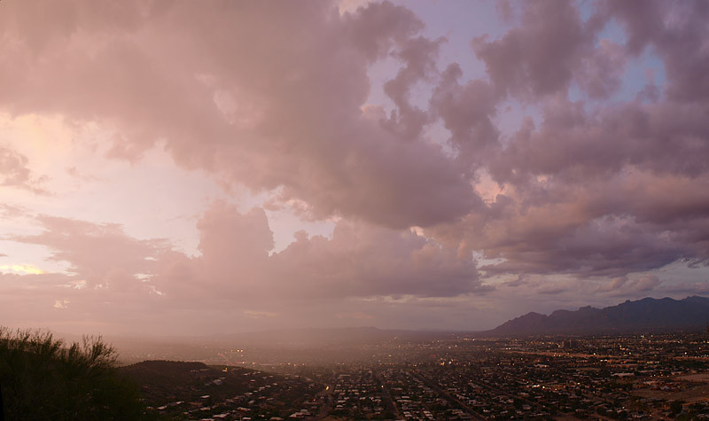 A home grown storm springs into life over downtown Tucson. Storms would fire up in minutes over the Catalina range and end up drifting over the city. It made for great photos. A good vantage point was crucial to capture such a scene. This was taken from 'A' mountain, just across the Interstate west of Tucson, a great place to sit and watch the storm erupting.