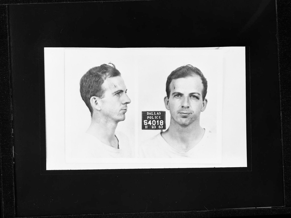 . Police mugshots of Oswald from the Dallas Police Department/Dallas Municipal Archives.