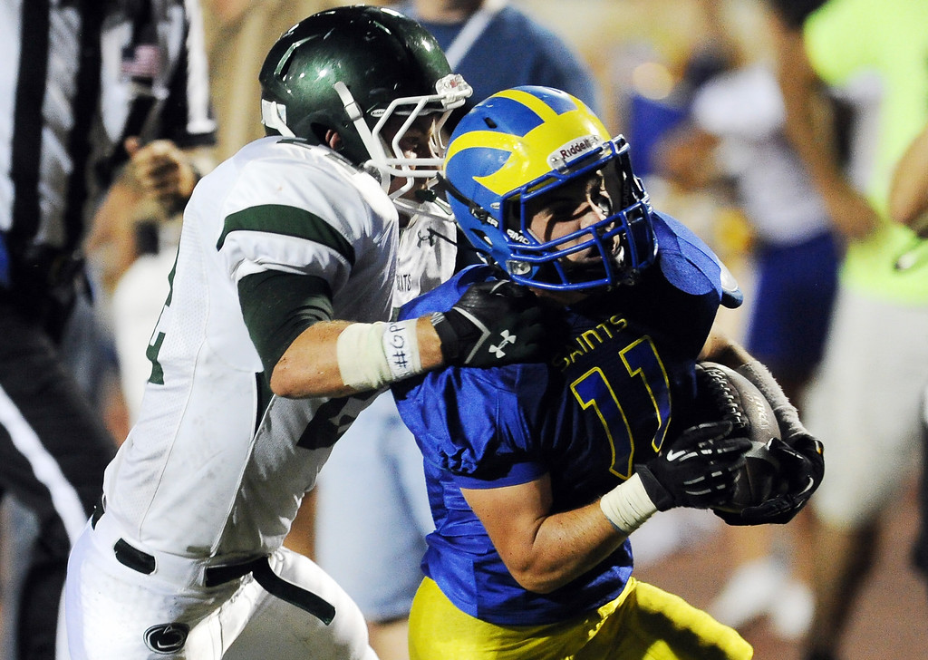 . San Dimas\' Erick Ware (11) runs for a touchdown against Bonita in the first half of a prep football game at Citrus College on Thursday, Aug. 29, 2013 in Glendora, Calif.   (Keith Birmingham/Pasadena Star-News)