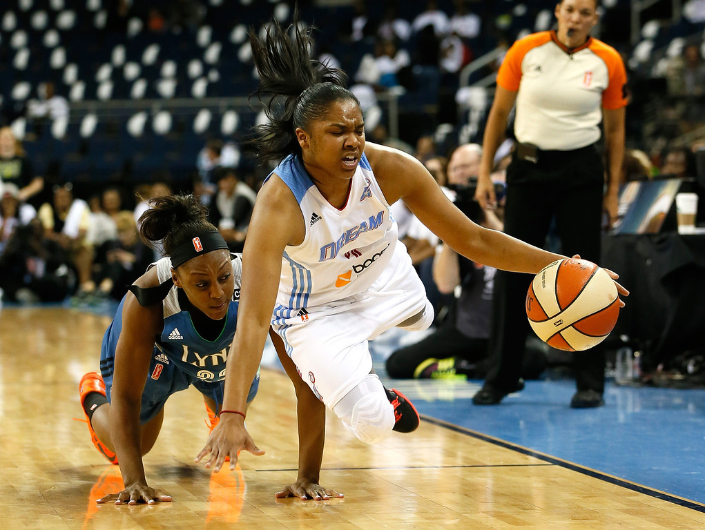 . ATLANTA, GA - OCTOBER 10:  Alex Bentley #2 of the Atlanta Dream steals the ball from Monica Wright #22 of the Minnesota Lynx during Game Three of the 2013 WNBA Finals at Philips Arena on October 10, 2013 in Atlanta, Georgia.  (Photo by Kevin C. Cox/Getty Images)