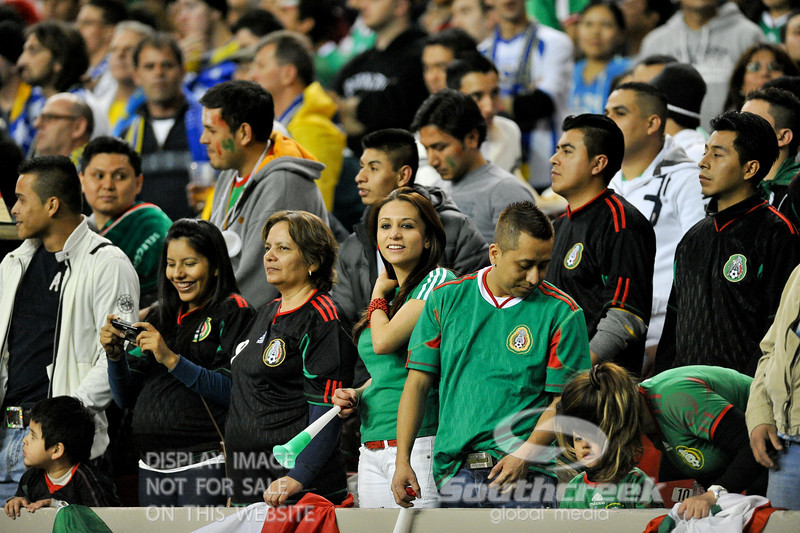 Mexico fans are all smiles during Soccer action between Bosnia-Herzegovina and Mexico.  Mexico defeated Bosnia-Herzegovina 2-0 in the game at the Georgia Dome in Atlanta, GA.
