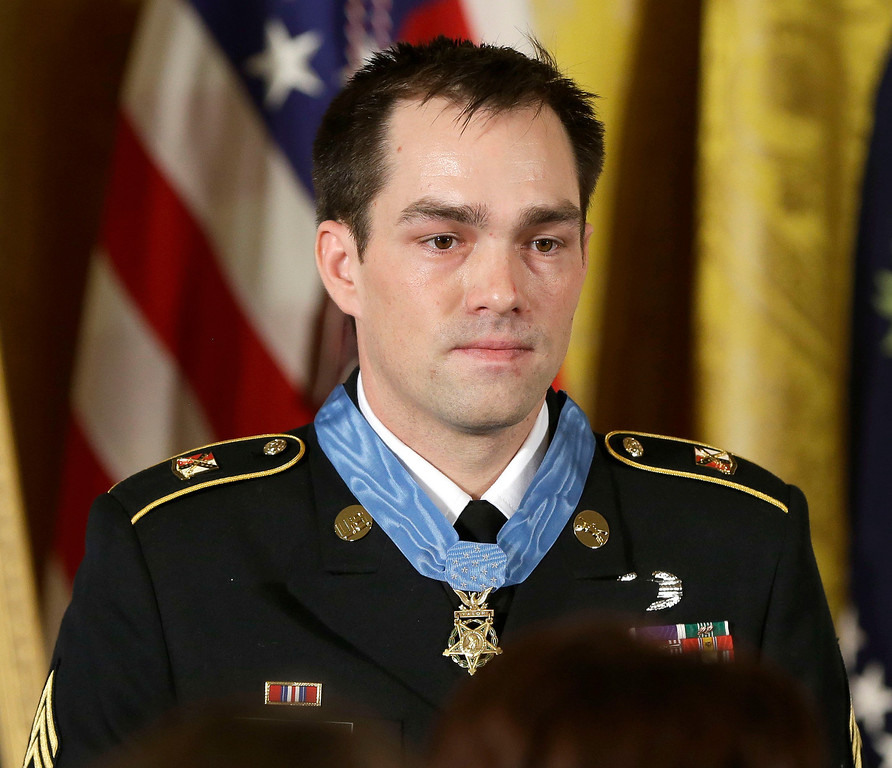 . Medal of Honor recipient, retired Staff Sgt. Clinton Romesha is seen on stage during the ceremony in the East Room of the White House in Washington, Monday, Feb. 11, 2013, where President Barack Obama bestowed the medal. (AP Photo/Pablo Martinez Monsivais)
