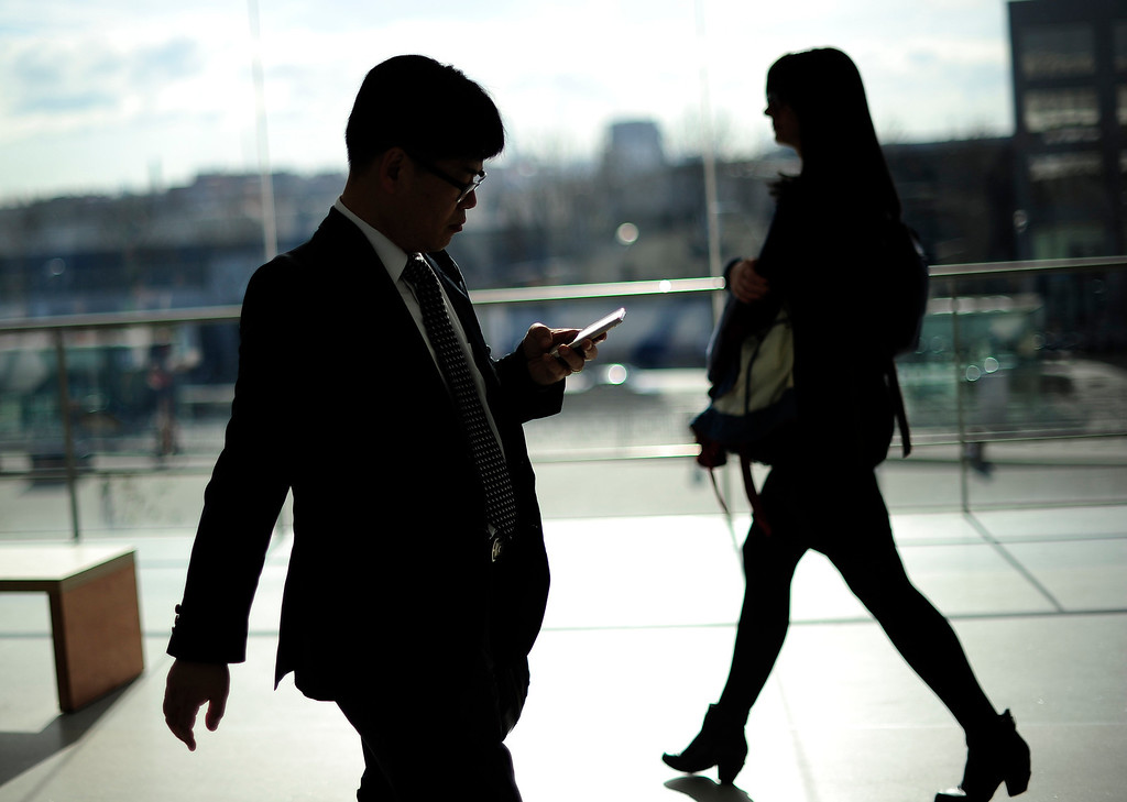 . A man uses a mobile device at the Mobile World Congress in Barcelona, on February 24, 2014.  The Mobile World Congress runs from the 24 to 27 February where participants and visitors alike can attend conferences, network, discover cutting-edge products and technologies at among the 1,700 exhibitors as well as seek industry opportunities and make deals.   JOSEP LAGO/AFP/Getty Images
