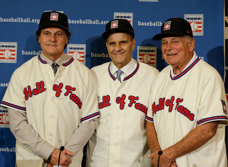 . Retired managers, from left, Tony La Russa, Joe Torre and Bobby Cox gather for a photo after it was announced that they were unanimously elected to the baseball Hall of Fame during MLB winter meetings in Lake Buena Vista, Fla., Monday, Dec. 9, 2013.(AP Photo/John Raoux)