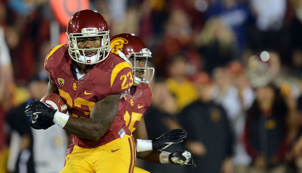 . USC\'s  Tre Madden #23 hauls in a touchdown pass during their game against Arizona at the Los Angeles Memorial Coliseum Thursday, October 10, 2013. (Photo by Hans Gutknecht/Los Angeles Daily News)