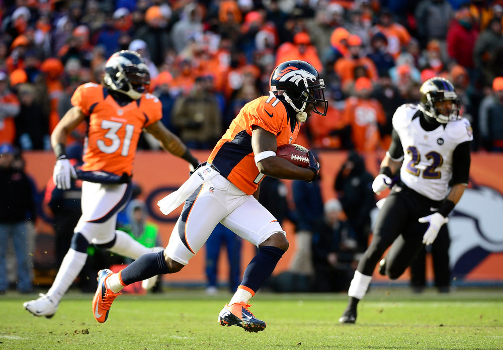 . Denver Broncos wide receiver Trindon Holliday (11) runs back a punt for an 89-yard touchdown on the Broncos\' first offensive play in the first quarter. The Denver Broncos vs Baltimore Ravens AFC Divisional playoff game at Sports Authority Field Saturday January 12, 2013. (Photo by AAron  Ontiveroz,/The Denver Post)