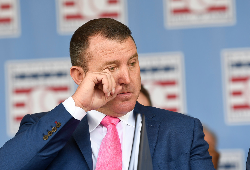 . National Baseball Hall of Fame inductee Jim Thome, reacts as his daugter Lila Thome sings the national anthem during an induction ceremony at the Clark Sports Center on Sunday, July 29, 2018, in Cooperstown, N.Y. (AP Photo/Hans Pennink)