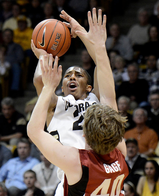 . University of Colorado\'s Spencer Dinwiddie shoots a three-pointer over John Gage during a game against Stanford on Thursday, Jan. 24, at the Coors Event Center on the CU campus in Boulder. Jeremy Papasso/ Camera