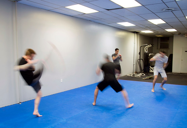 01/07/20 Wesley Bunnell | StaffrrKick boxers warm up at New Britain Judo & Dynamic Arts on West Main St in New Britain.