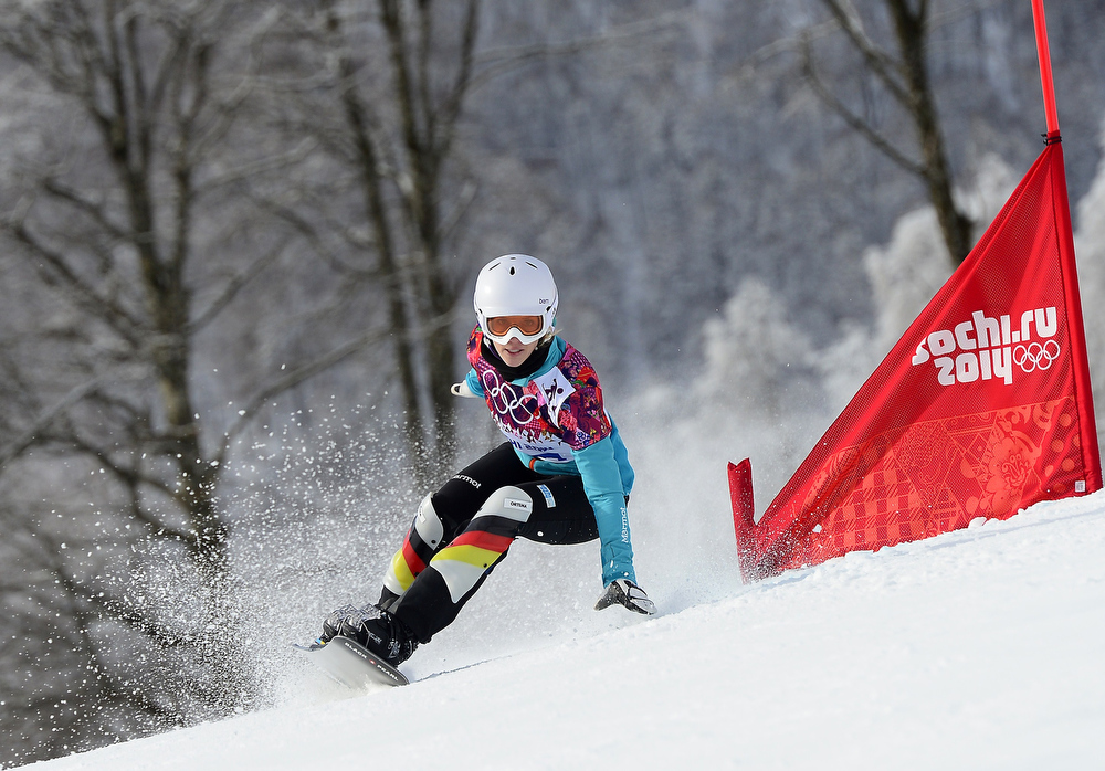. Germany\'s Isabella Laboeck competes in the Women\'s Snowboard Parallel Giant Slalom elimination run at the Rosa Khutor Extreme Park during the Sochi Winter Olympics on February 19, 2014.  JAVIER SORIANO/AFP/Getty Images