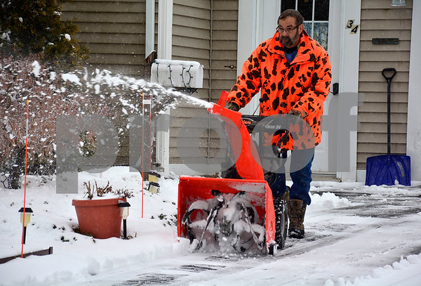 1/17/2018 Mike Orazzi   Staff Steve Fetko while clearing snow in his neighborhood along Holt Place in Bristol during Wednesday's storm.