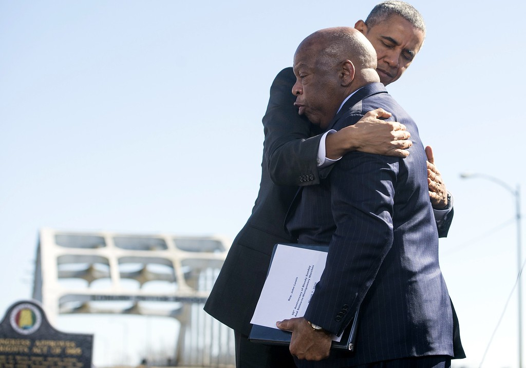 ". US President Barack Obama hugs US Representative John Lewis, Democrat of Georgia, one of the original marchers at Selma, during an event marking the 50th Anniversary of the Selma to Montgomery civil rights marches at the Edmund Pettus Bridge in Selma, Alabama, on March 7, 2015. Obama declared Saturday on the 50th anniversary of a savagely repressed civil rights march in Selma, Alabama, that it was a global inspiration for those fighting for freedom. ""From the streets of Tunis to the Maidan in Ukraine, this generation of young people can draw strength from this place, where the powerless could change the world\'s greatest superpower, and push their leaders to expand the boundaries of freedom,\"" he said.  AFP PHOTO / SAUL LOEB/AFP/Getty Images"