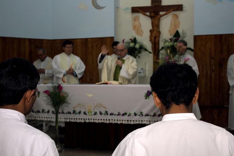 Fr. Attilio, SCJ prays over those who took Final Vows.