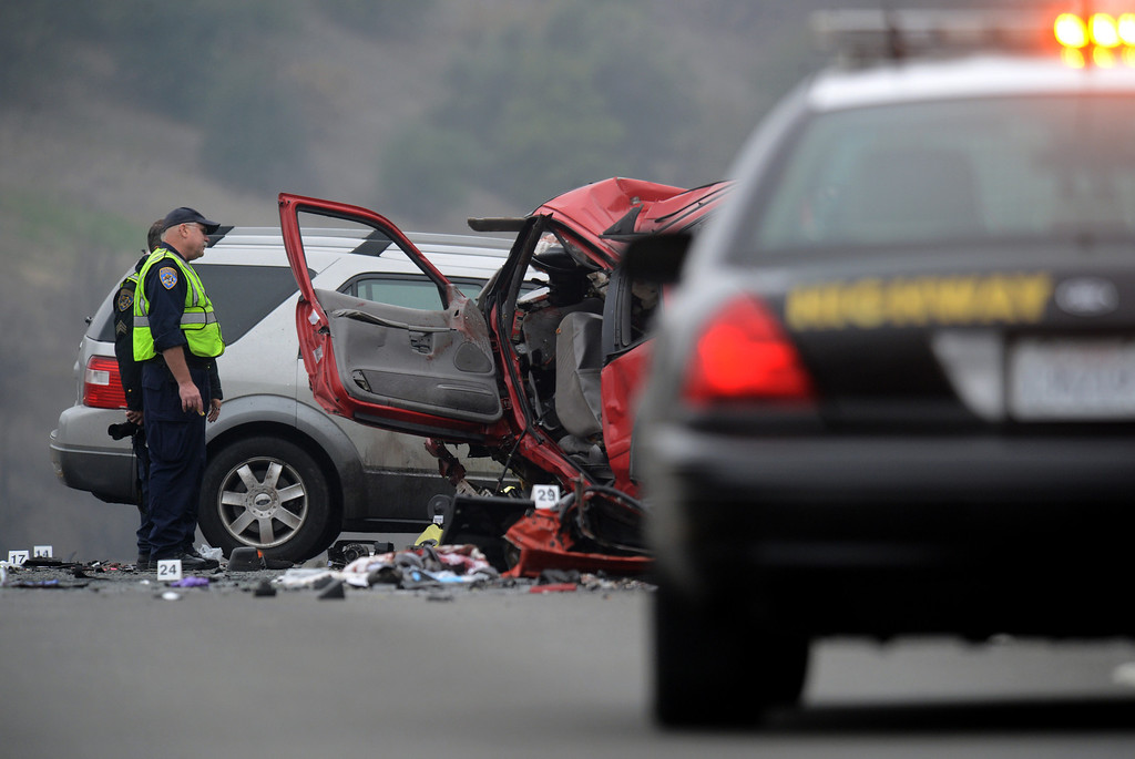 . CHP investigates the scene of a fatal traffic collision, where six people were killed, involving a wrong way driver on the westbound 60 freeway in Diamond Bar, CA., Sunday, February 9, 2014. (Photo by Jennifer Cappuccio Maher/Inland Valley Daily Bulletin)
