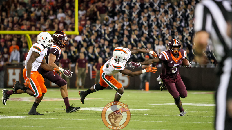 WR Cam Phillips holds off a Miami defender on another catch and run. (Mark Umansky/TheKeyPlay.com)