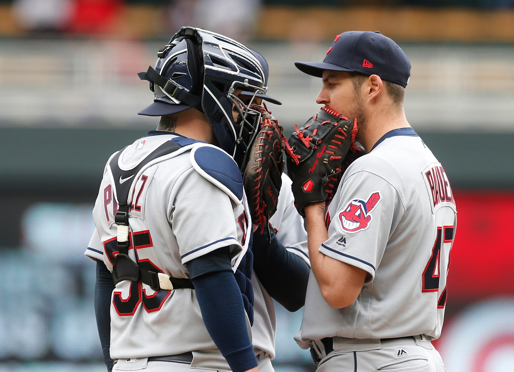 . Cleveland Indians pitcher Trevor Bauer, right, has a chat with catcher Roberto Perez in the fourth inning of a baseball game against the Minnesota Twins Thursday, April 20, 2017, in Minneapolis. (AP Photo/Jim Mone)