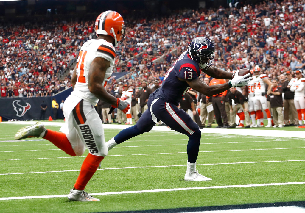 . Cleveland Browns\' Jamar Taylor (21) gives chase as Houston Texans\' Braxton Miller (13) heads to the end zone for a touchdown in the first half of an NFL football game, Sunday, Oct. 15, 2017, in Houston. (AP Photo/Eric Gay)