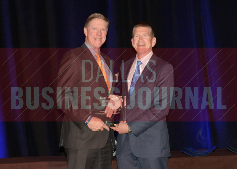 Liberty Mutual Insurance Company was presented the best Outside Relocation award from Bret Robertson of presenting sponsor CF Accountants & Consultants.