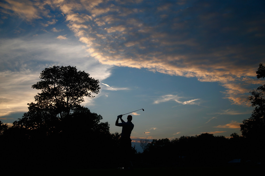 . DUBLIN, OH - OCTOBER 04:  Tiger Woods of the U.S. Team hits his tee shot on the 12th hole during the Day Two Foursome Matches at the Muirfield Village Golf Club on October 4, 2013  in Dublin, Ohio.  (Photo by Matt Sullivan/Getty Images)