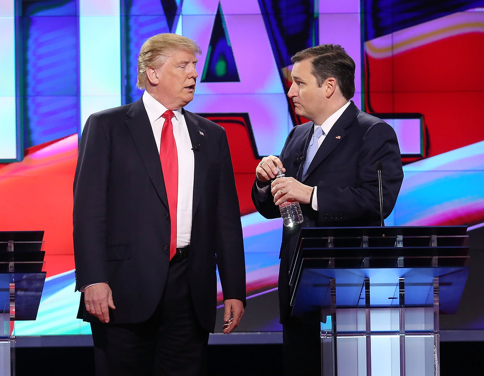 ". File - Republican presidential candidates Donald Trump and Sen. Ted Cruz (R-TX), talk during a broadcast break in the CNN, Salem Media Group, The Washington Times Republican Presidential Primary Debate on the campus of the University of Miami on March 10, 2016 in Coral Gables, Florida. Cruz announced Friday, Sept. 23, 2016, he will vote for Donald Trump, a dramatic about-face for the Texas senator who previously called the New York businessman a ""pathological liar\"" and \""utterly amoral.\""   (Photo by Joe Raedle/Getty Images)"