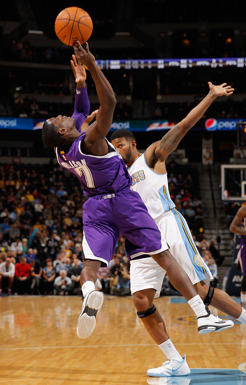 . DENVER, CO - NOVEMBER 03:  Darren Collison #7 of the Sacramento Kings is fouled by Alonzo Gee #1 of the Denver Nuggets at Pepsi Center on November 3, 2014 in Denver, Colorado. NOTE TO USER: User expressly acknowledges and agrees that, by downloading and or using this photograph, User is consenting to the terms and conditions of the Getty Images License Agreement.  (Photo by Doug Pensinger/Getty Images)