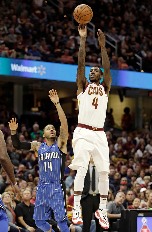 . Cleveland Cavaliers\' Iman Shumpert (4) shoots over Orlando Magic\'s D.J. Augustin (14) in the first half of an NBA basketball game, Saturday, Oct. 21, 2017, in Cleveland. (AP Photo/Tony Dejak)